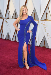 Nancy O'Dell donned an embellished one-sleeve gown in a dazzling electric-blue hue for the 2018 Oscars.