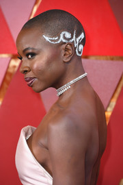 Danai Gurira adorned her buzzcut with white tribal markings for the 2018 Oscars.