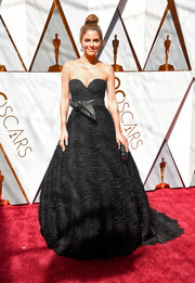 Maria Menounos exuded classic elegance wearing this richly textured strapless ball gown by Celia Kritharioti at the 2018 Oscars.