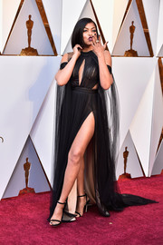 Taraji P. Henson vamped it up in a high-slit black keyhole-cutout gown by Vera Wang at the 2018 Oscars.
