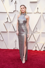 Brie Larson looked radiant in a high-slit silver halter gown by Celine at the 2019 Oscars.