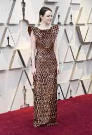 Emma Stone was edgy-glam in a bronze sequined gown with pointy shoulders at the 2019 Oscars.