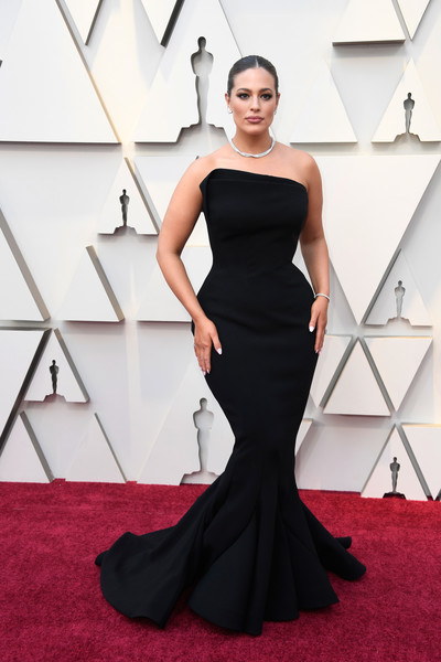 More Pics of Ashley Graham Classic Bun (6 of 16) - Updos Lookbook - StyleBistro [dress,red carpet,gown,clothing,fashion model,carpet,shoulder,flooring,strapless dress,hairstyle,arrivals,ashley graham,academy awards,hollywood,highland,california,annual academy awards]