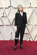 Elsie Fisher styled her look with a croc-embossed purse that looked like a gift box.