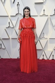 Rachel Weisz looked modern in a red Givenchy Couture gown with a latex bodice and a beaded midsection at the 2019 Oscars.