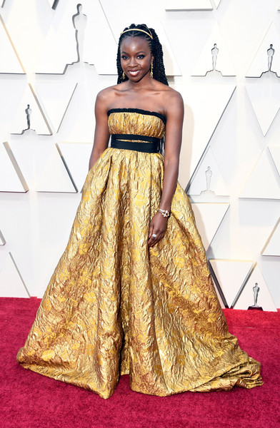 Danai Gurira looked ultra glam in a strapless gold empire gown by Brock Collection at the 2019 Oscars.