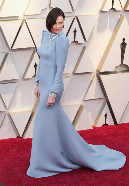 Charlize Theron made a grand entrance in a flowing blue Dior Couture gown at the 2019 Oscars.
