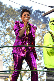 Kat Graham stood out in a super-sparkly magenta pantsuit during Macy's Thanksgiving Day Parade.