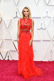 Giuliana Rancic glammed up in a beaded and feathered red gown by Atelier Zuhra for the 2020 Oscars.