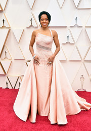 Regina King made a grand entrance in a blush one-shoulder ballgown by Atelier Versace at the 2020 Oscars.