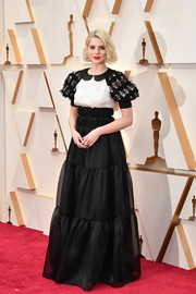 Lucy Boynton looked demure in a bow-detailed black-and-white empire gown by Chanel at the 2020 Oscars.
