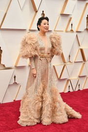 Sandra Oh got majorly dolled up in a sequined and ruffled gown by Elie Saab Couture for the 2020 Oscars.