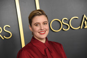Greta Gerwig styled her hair into a pompadour for the 2020 Oscar nominees luncheon.