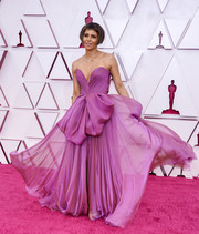 Halle Berry attended the 2021 Oscars wearing a strapless purple gown with oversized bow detailing.