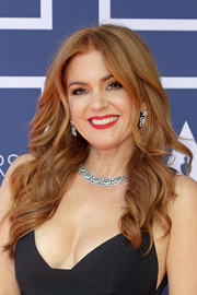Isla Fisher opted for a loose wavy hairstyle when she attended the 2021 Oscars.