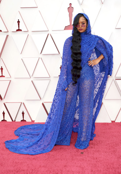 Her turned heads in a beaded and hooded blue jumpsuit by Dundas at the 2021 Oscars.