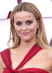 Reese Witherspoon chose a simple straight center-parted cut for the 2021 Oscars.