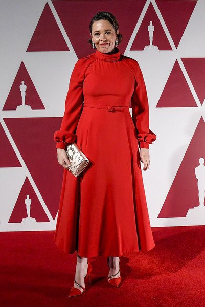 A pair of embellished red pumps polished off Olivia Colman's look.