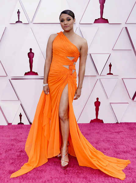 Ariana DeBose sealed off her look with strappy gold platforms by Stuart Weitzman.