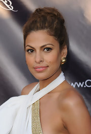 Eva showed off her halter neckline and gold stud earrings with a high, twisted bun.