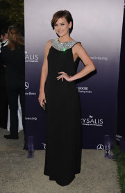 Jessica looked glamorous in a long black gown with a jeweled neckline.