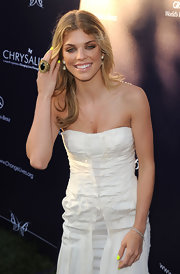 AnnaLynne rocked a huge gold and onyx cocktail ring with her all-white ensemble.