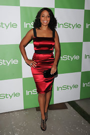 Sanaa Lathan was sleek in satin at the InStyle party. She paired her ruby red dress with strappy heels.