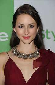 Troian paired her burgundy dress with a stunning silver statement necklace.