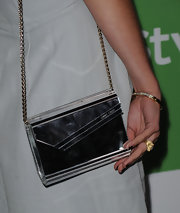 Jessica Stroup paired her sleek dress with a cool mirror chain strap purse.