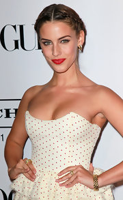 Jessica Lowndes wore a large woven cable cuff to the 9th Annual 'Teen Vogue' young Hollywood party. In addition, she wore golden hoop earrings, a cable threads ring and a large crossover ring.