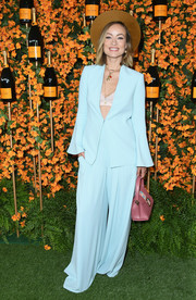 Olivia Wilde looked cool in a pastel-blue Alice + Olivia suit teamed with a pink lace bra at the Veuve Clicquot Polo Classic Los Angeles.
