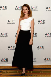 Lily James looked elegant in a one-shoulder monochromatic black and white gown at the Winter TCA Tour.