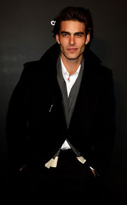 Jon layered a sophisticated black and white checkered scarf under his wool coat.