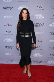Brooke Shields donned a fitted black sweater dress with a fluted hem for the 2019 AAFA American Image Awards.
