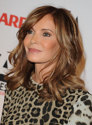 Jaclyn wore her hair in a wavy style with highlights that complemented her skin tone beautifully.
