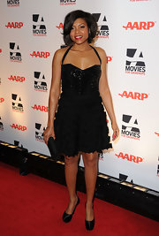 Taraji shimmered in a little black cocktail dress with a retro halter strap and textured skirt at the Movies For Grownups Awards.