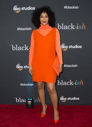 Taking matchy-matchy to the extreme, Tracee Ellis Ross accessorized with an orange envelope clutch.