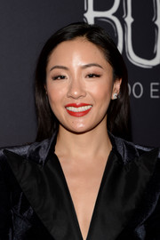 Constance Wu rounded out her look with a pair of diamond studs.