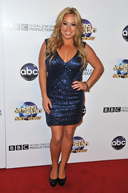 Sabrina Bryan chose a midnight blue sequined dress to show off her curves on the red carpet.