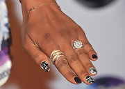 Brandy rocked the nail art trend with multi patterned nails.