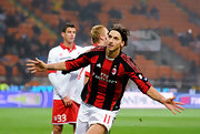 Zlatan Ibrahimovic celebrates during a match - while wearing his AC Milan kit.