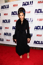 Andra Day looked lavish in a black fur-trimmed coat at the Bill of Rights dinner.