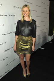 Amy Smart donned on-trend leopard pumps to the launch of IN ADD MINUS. She paired them with a leather looking top and gold brocade skirt.