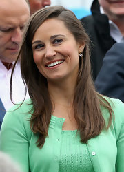 Pippa kept her look sophisticated with a side part and straight locks at the Aegon championships.