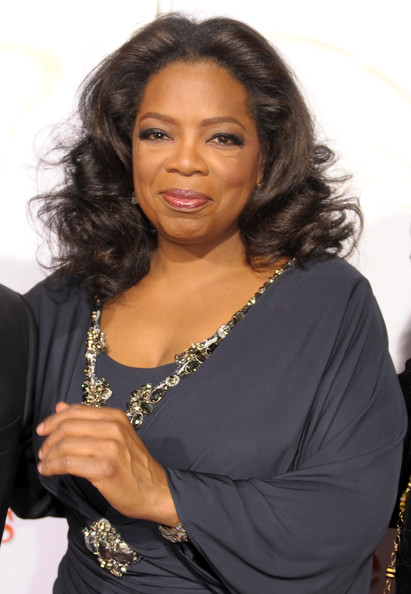 Oprah showed off her center part curls while attending the screening of 'Precious'.