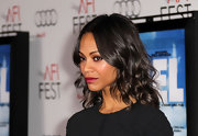 Zoe Saldana finished off her look with elegantly waved shoulder length tresses. A simple center part and a few spritz of hair spray is all this look needed.