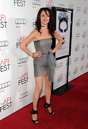 Juliette Lewis goes exotic chic in Jimmy Choo Zoom Snake Sandals. The snake and rooster heels toughen up a pastel micro mini cocktail dress.