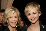 Actresses Jane Fonda (L) and Jennifer Lawrence attend the reception for