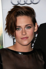 Kristen Stewart carried her edgy look over to her makeup with silver-rimmed eyes at the AFI FEST 2014 screening of 'Still Alice.'