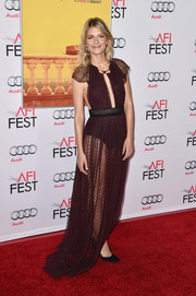 Melanie Laurent put on a daring display in a sheer, dotted burgundy cutout gown by Burberry Prorsum at the AFI Fest opening night premiere of 'By the Sea.'